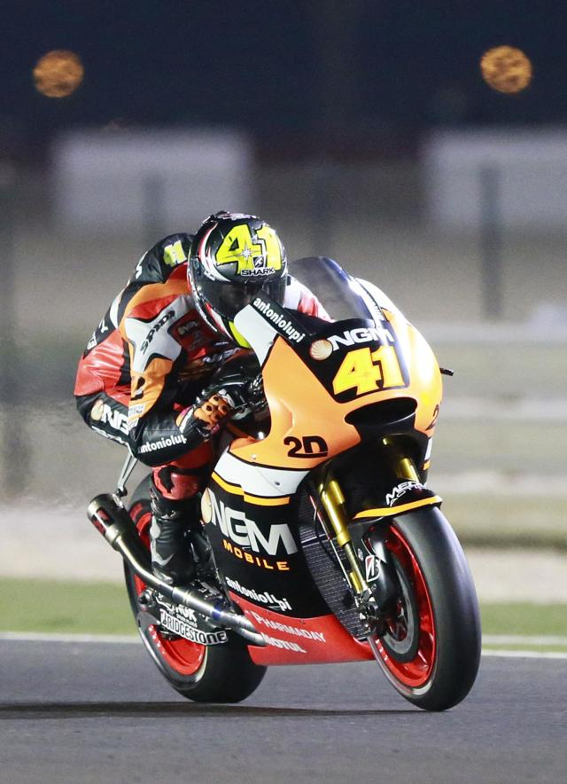 NGM Mobile Forward Racing MotoGP rider Aleix Espargaro of Spain races during a free practice session at the MotoGP World Championship at the Losail International circuit in Doha March 22, 2014. REUTERS/Mohammed Dabbous (QATAR - Tags: SPORT MOTORSPORT)