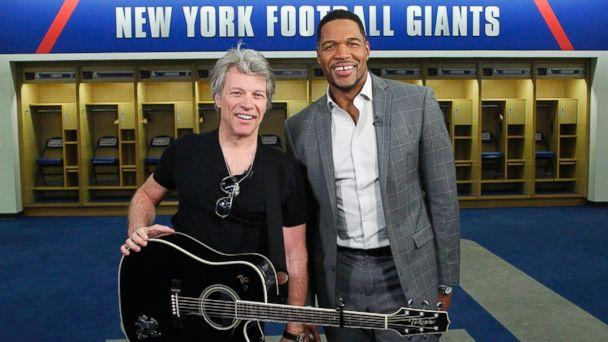 PHOTO: ABC News' Michael Strahan, right, joined Jon Bon Jovi at MetLife Stadium in New Jersey as the rock singer surprised the graduating class at Fairleigh Dickinson University commencement with a performance. (Lou Rocco/ABC )