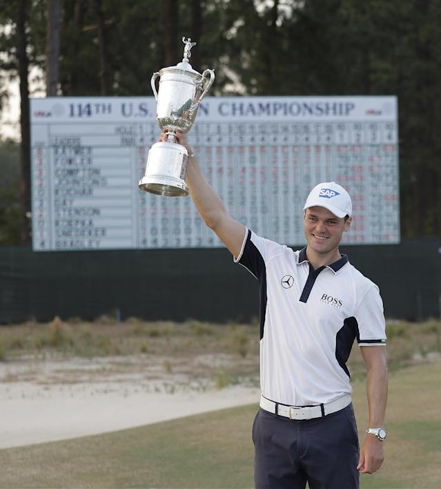 Martin Kaymer, of Germany, poses with trophy after wining the U.S. Open golf tournament in Pinehurst, N.C., Sunday, June 15, 2014. (AP Photo/Eric Gay)