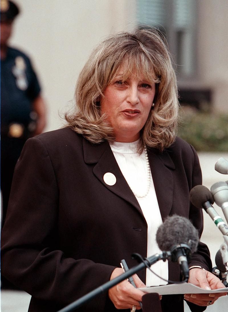 "Linda Tripp talks to the press outside the Federal Courthouse July 29, 1998. After finishing her testimony before a grand jury, Linda Tripp, whose tape recordings of Monica Lewinsky led to an investigation of an alleged presidential affair, spoke at length publicly for the first time, saying she was an ""average American."""