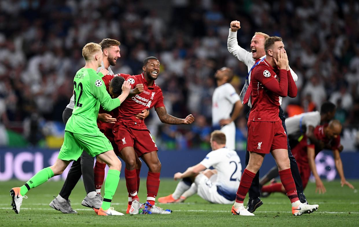 MADRID, SPAIN - JUNE 01: Liverpool players celebrate at full time during the UEFA Champions League Final between Tottenham Hotspur and Liverpool at Estadio Wanda Metropolitano on June 01, 2019 in Madrid, Spain. (Photo by Harriet Lander/Copa/Getty Images)