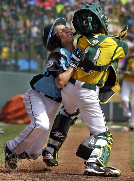 Petaluma, Calif., catcher Austin Paretti, right, blocks the plate and makes the tag on Goodlettsville, Tenn.'s Blake Osborne in the second inning of a baseball game during Little League World Series pool play in South Williamsport, Pa., Sunday, Aug. 19, 2012. Goodlettsville won 9-6. (AP Photo/Gene J. Puskar)