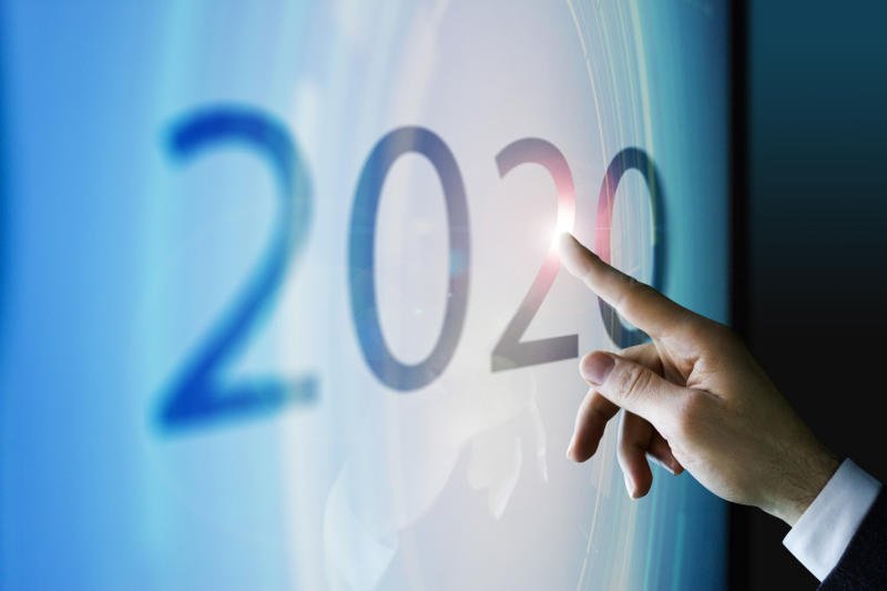 "Finger touching ""2020"" on touchscreen."