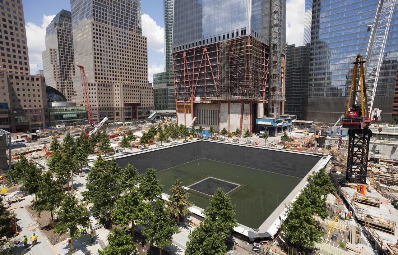 Work continues on the National September 11 Memorial at the World Trade Center site, Friday, July 15, 2011 in New York. The memorial will be dedicated in a ceremony on September 11, 2011, the tenth anniversary of the terrorist attacks. (AP Photo/Mark Lennihan)