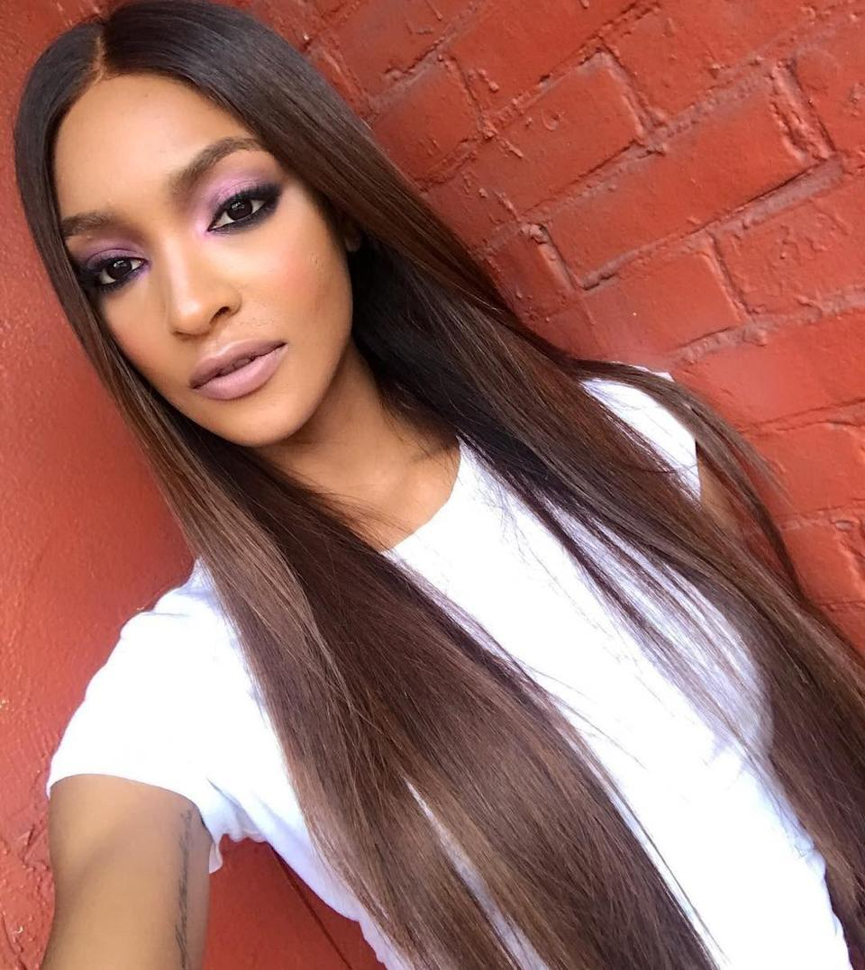 "The trick to nailing this perfect fall color is <a href=""https://www.glamour.com/story/sarah-hyland-dark-brown-hair?mbid=synd_yahoo_rss"" rel=""nofollow noopener"" target=""_blank"" data-ylk=""slk:the contrast created"" class=""link rapid-noclick-resp"">the contrast created</a> between a warm auburn tint and a dark brunette base. The layering is super subtle and looks amazing on every length and texture."