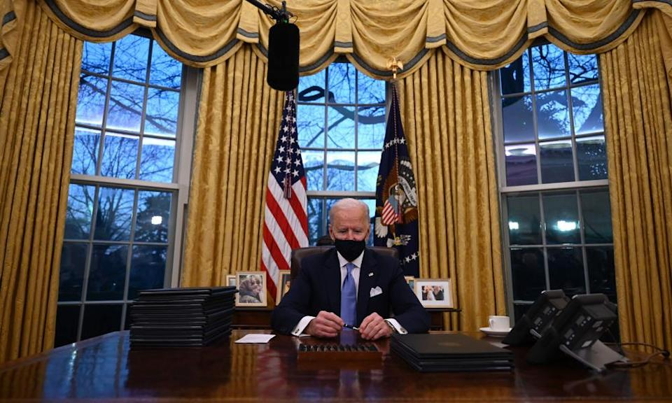 Joe Biden in the newly decorated Oval Office.