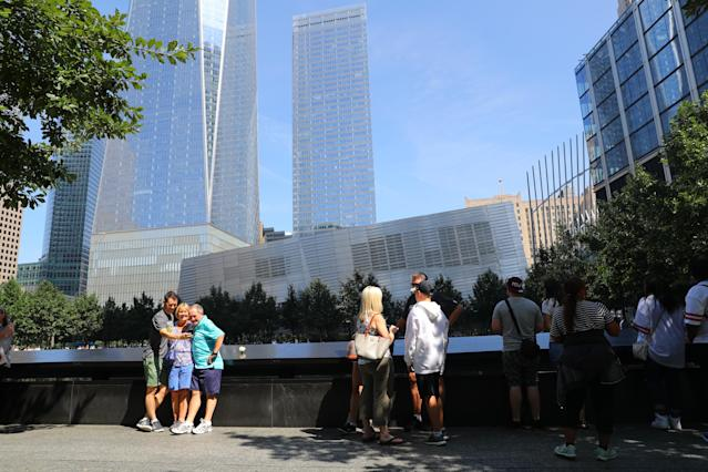 <p>Visitors gather to pay tribute to the victims of the 9/11 attacks near one of two reflecting pools at the National September 11 Memorial & Museum on Sept. 4, 2017. (Photo: Gordon Donovan/Yahoo News) </p>