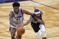 Detroit Pistons forward Saddiq Bey (41) and New Orleans Pelicans forward Brandon Ingram reach for the ball during the first half of an NBA basketball game in New Orleans, Wednesday, Feb. 24, 2021. (AP Photo/Gerald Herbert)