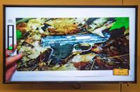 A photo of a small handgun found in a wooded area near the crime scene was displayed during the murder trial of the former New England Patriots player Aaron Hernandez at the Bristol County Superior Court in Fall River, Massachusetts February 13, 2015. REUTERS/Aram Boghosian/Pool (UNITED STATES - Tags: CRIME LAW SPORT FOOTBALL)