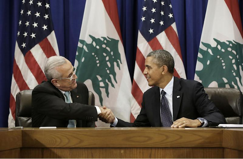President Barack Obama shakes hands with Lebanese President Michel Suleiman during their bilateral meeting at the United Nations headquarters, Tuesday, Sept. 24, 2013. (AP Photo/Pablo Martinez Monsivais)