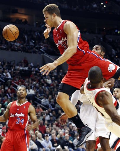 Los Angeles Clippers forward Blake Griffin, top, loses the ball as he jumps over Portland Trail Blazers guard Ronnie Price on a fast break during the first quarter of their NBA basketball game in Portland, Ore., Thursday, Nov. 8, 2012. Clippers guard Willie Green watches at left. (AP Photo/Don Ryan)