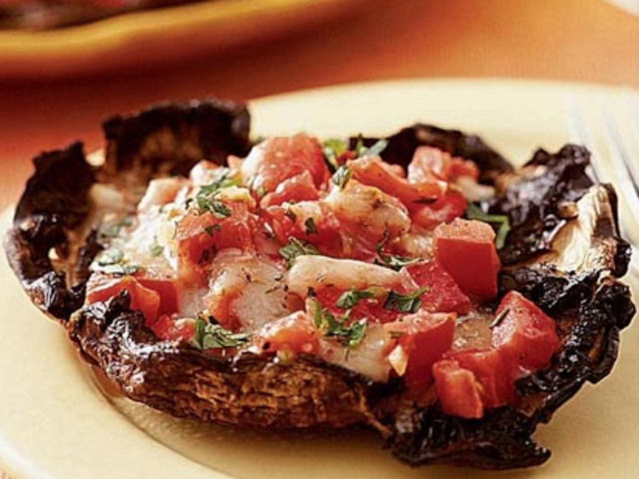 """<p>If you're looking for an easy crowd-pleaser, grilled portobello mushrooms are the way to go. These giant portobello mushrooms are stuffed with some incredibly tasty ingredients like cheese, tomatoes, and fresh herbs, and are then grilled to absolute perfection. This recipe works well as an <a href=""""https://www.myrecipes.com/appetizer-recipes/"""">appetizer</a> or even as an impressive side dish. In the store, look for portobello mushrooms that have a clean exterior and aren't bruised on the caps. Also, because you're stuffing them, look for mushrooms with small stems that will be easier to remove. If you aren't crazy about mozzarella, feel free to use another type of cheese, such as Parmesan, instead. </p> <p><a href=""""https://www.myrecipes.com/recipe/grilled-stuffed-portobello-mushrooms"""">Grilled Stuffed Portobello Mushrooms Recipe</a></p>"""