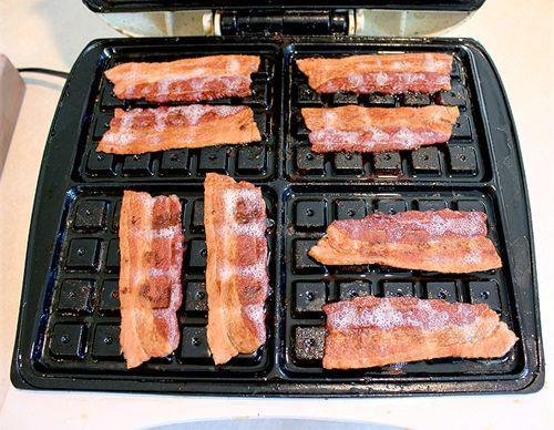 """<p>We'll try any new way to eat (and cook) bacon.</p><p>Get the recipe from <a rel=""""nofollow noopener"""" href=""""http://www.onegoodthingbyjillee.com/2013/03/14-ways-to-cook-bacon-including-my-favorite-in-the-waffle-maker.html"""" target=""""_blank"""" data-ylk=""""slk:One Good Thing by Jillee"""" class=""""link rapid-noclick-resp"""">One Good Thing by Jillee</a>.</p>"""