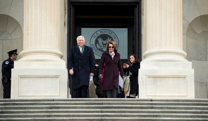 House Minority Whip Steny Hoyer (D-Md.) and House Minority Leader Nancy Pelosi (D-Calif.) lead the way down the House steps for the House Democratic Caucus media event to mark the fifth anniversary of President Barack Obama signing into law the Affordable Care Act on March 24, 2015.