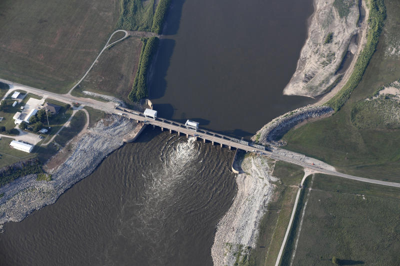 FILE - This Aug. 2, 2018, file photo shows the Old River Control Structure, a floodgate system which regulates the flow of water leaving the Mississippi River into the Atchafalaya River, in Vidalia, La. The state of Mississippi is suing the federal government for at least $25 million, claiming a federal dam complex in Louisiana that keeps the Mississippi River from changing course is harming state land. The suit was filed Monday in the Court of Federal Claims by Mississippi officials on behalf of three school districts. (AP Photo/Gerald Herbert, File)