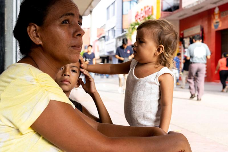 TAPACHULA, Mexico – Waldina Bonilla Rodriguez, from Honduras, tried not to lose sight of her 8-year-old son, Oscar, as he weaved in and out of the crowds in his bare feet begging for money. She held a plastic cup while her 2-year-old daughter, Devlin Nicol, tugged at her tank top. The girl cried for attention, her blond hair matted in knots.