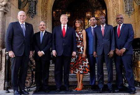 U.S. President Trump and first lady Melania Trump pose before a meeting with St Lucia Prime Minister Allen Chastanet, Dominican Republic President Danilo Medina, Jamaica Prime Minister Andrew Holness, Haiti President Jovenel Moise and Bahamas Prime Minister Hubert Minnis at Trump's Mar-a-Lago estate in Palm Beach, Florida, U.S., March 22, 2019.   REUTERS/Kevin Lamarque