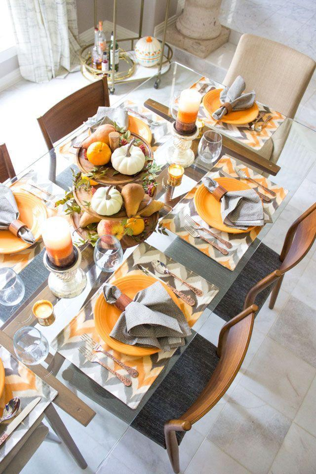 "<p>Perfect for those under a bit of time crunch, simply display an assortment of mini pumpkins and pears on a tiered serving tray. Weave in patterned placemats and fun silverware to make your holiday table stand out. </p><p><em><a href=""https://designimprovised.com/2016/10/harvest-themed-fall-dining-room-decor.html"" rel=""nofollow noopener"" target=""_blank"" data-ylk=""slk:Get the tutorial at Design Improvised »"" class=""link rapid-noclick-resp"">Get the tutorial at Design Improvised »</a></em></p>"