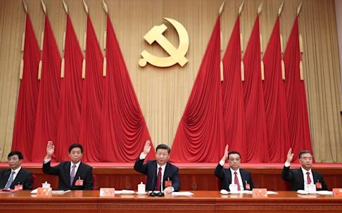 At next week's Politburo meeting, President Xi Jinping (centre) is expected to set the tone for China's upcoming economic policies. Photo: Xinhua
