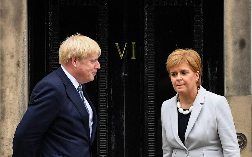 FASLANE, SCOTLAND - JULY 29: Scotland's First Minister Nicola Sturgeon welcomes Prime Minister Boris Johnson outside Bute House on July 29, 2019 in Edinburgh, Scotland. The PM is due to announce £300m of funding to help communities in Scotland, Wales and Northern Ireland. ( (Photo by Jeff J Mitchell/Getty Images) - Jeff J Mitchell/Getty Images