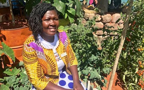 Clarah Zinyame, Camfed Alumnae Association (Cama) member and agricultural entrepreneur from Zimbabwe, at the garden in Chelsea - Credit: Telegraph