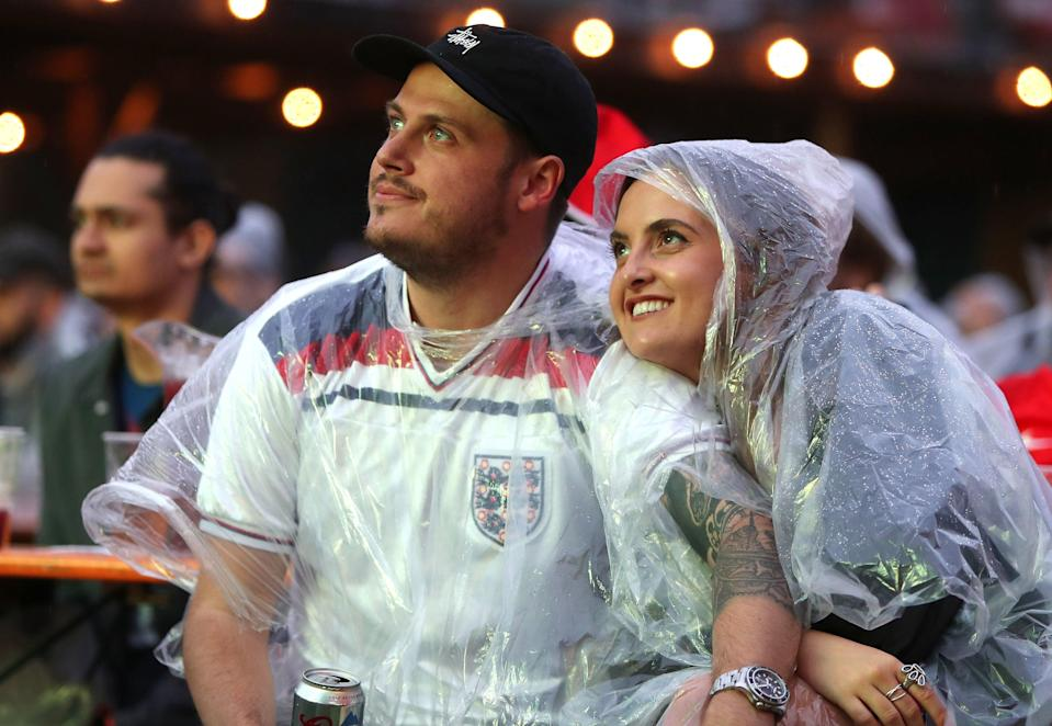 Fans brave the weather to watch the Euros (PA)