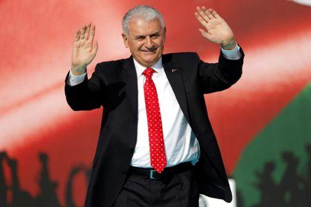 FILE PHOTO: Turkish Prime Minister Binali Yildirim greets the crowd as he takes part in a protest in Istanbul, Turkey May 18, 2018. REUTERS/Murad Sezer