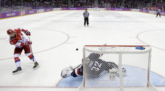 USA goaltender Jonathan Quick stops the last shot by Russia forward Ilya Kovalchuk in a shootout in the men's ice hockey game at the 2014 Winter Olympics, Saturday, Feb. 15, 2014, in Sochi, Russia. (AP Photo/Mark Humphrey )