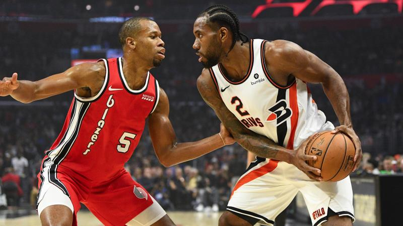 LOS ANGELES, CA - NOVEMBER 07: Los Angeles Clippers Forward Kawhi Leonard (2) looks to drive past Portland Trail Blazers Forward Rodney Hood (5) during a NBA game between the Portland Trailblazers and the Los Angeles Clippers on November 7, 2019 at STAPLES Center in Los Angeles, CA. (Photo by Brian Rothmuller/Icon Sportswire via Getty Images)