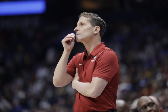 """FILE - In this March 11, 2020, file photo, Arkansas head coach Eric Musselman watches the action in the first half of an NCAA college basketball game against Vanderbilt in the Southeastern Conference Tournament in Nashville, Tenn. As thousands of college athletes and coaches across the country try to adjust after the sudden suspensions of entire seasons of competition and perhaps more so the camaraderie of daily practices, training sessions and team meals, communication specialists and mental health professionals are encouraging those involved to allow these young men and women to go through the stages of grieving as needed. """"I think for all of us in college athletics the No. 1 focus always has to be on the student's well-being,"""" Musselman said. (AP Photo/Mark Humphrey, File)"""