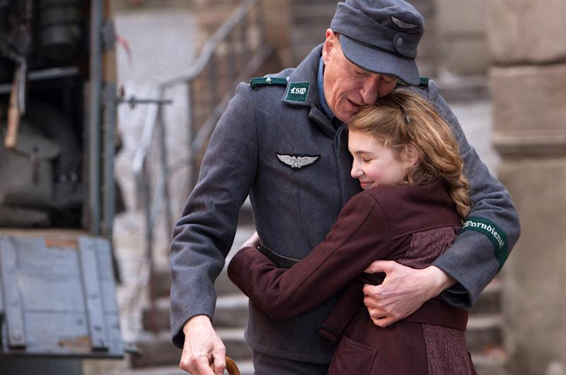 "This image released by 20th Century Fox shows Geoffrey Rush, left, and Sophie Nélisse in a scene from ""The Book Thief,"" about a girl who loves books. (AP Photo/20th Century Fox, Jules Heath)"
