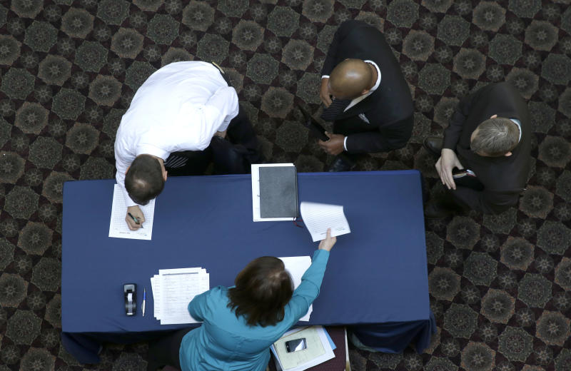 US job openings fall in December from 5-year high