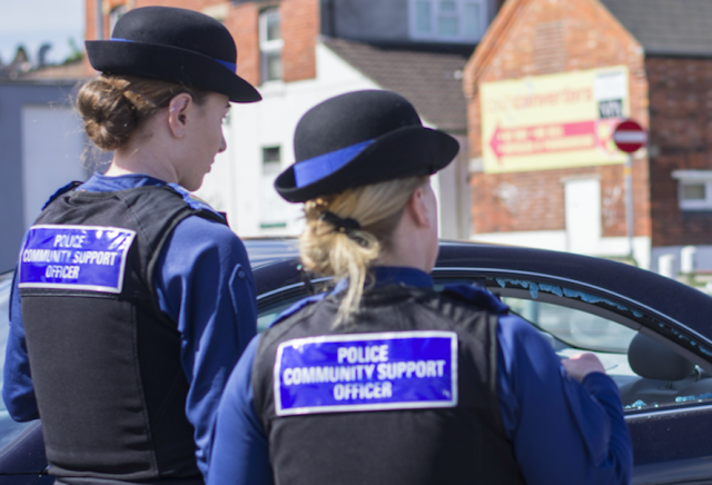 Police community support officers at the scene in Swindon, Wiltshire. (SWNS)