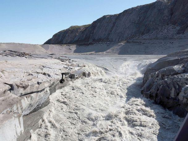 PHOTO: Water from melting ice flows into the fjord near Kangerlussaq in western Greenland, Aug. 1, 2019. (Caspar Haarlov/AP)