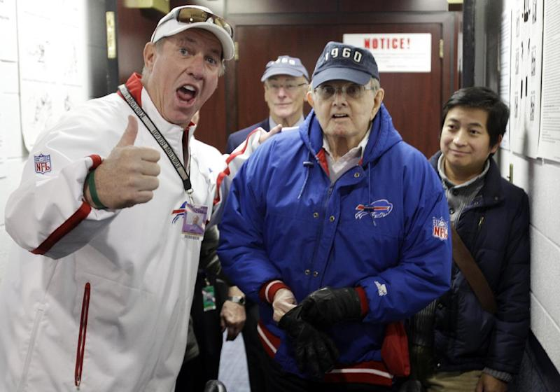 FILE - In this Nov. 6, 2011, file photo, former Buffalo Bills quarterback Jim Kelly, left, poses for a photo with Bills owner Ralph Wilson Jr., right, before an NFL football game against the New York Jets in Orchard Park, N.Y. Bills owner Wilson Jr. has died at the age of 95 at his home in Grosse Pointe Shores, Mich. Bills president Russ Brandon made the announcement at the NFL winter meetings in Orlando, Fla., Tuesday, March 25, 2014. Wilson Jr. was one of the original founders of the American Football League and owned the Bills for the last 54 years. (AP Photo/David Duprey, File)