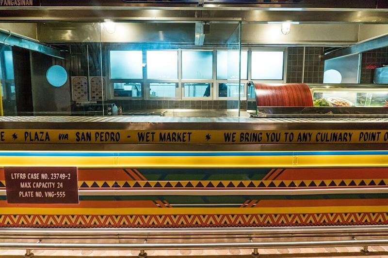 The counter is decorated in the dizzying colors of a Jeepney, a popular form of public transportation in the Philippines.