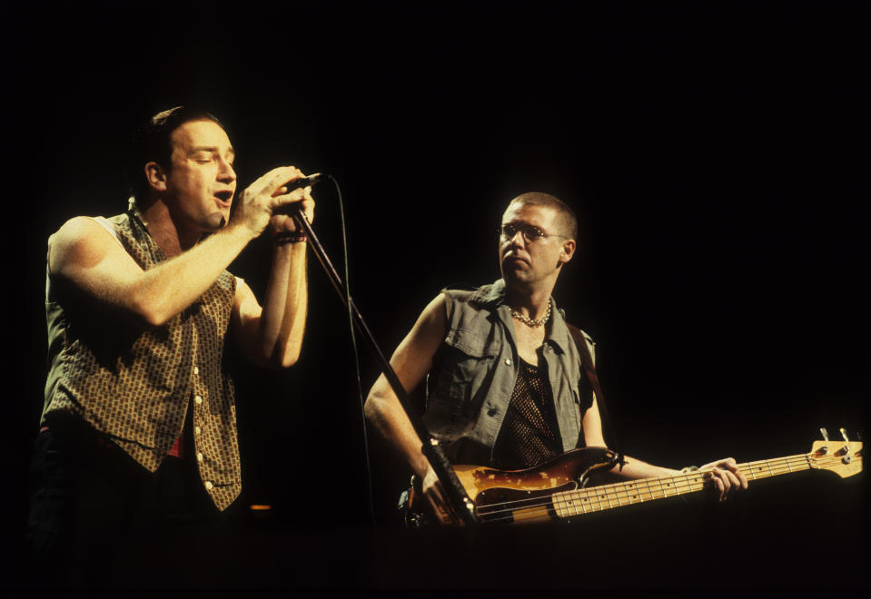 Bono and Adam Clayton of U2 perform on stage on the Joshua Tree tour, Vorst Nationaal, Brussels, Belgium, 8th July 1987. (Photo by Rob Verhorst/Redferns)