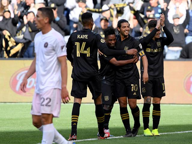 "<a class=""link rapid-noclick-resp"" href=""/soccer/players/373184/"" data-ylk=""slk:Carlos Vela"">Carlos Vela</a> (10) celebrates with his LAFC teammates after scoring the only goal in a win over Inter Miami on Sunday. (Photo by Harry How/Getty Images)"