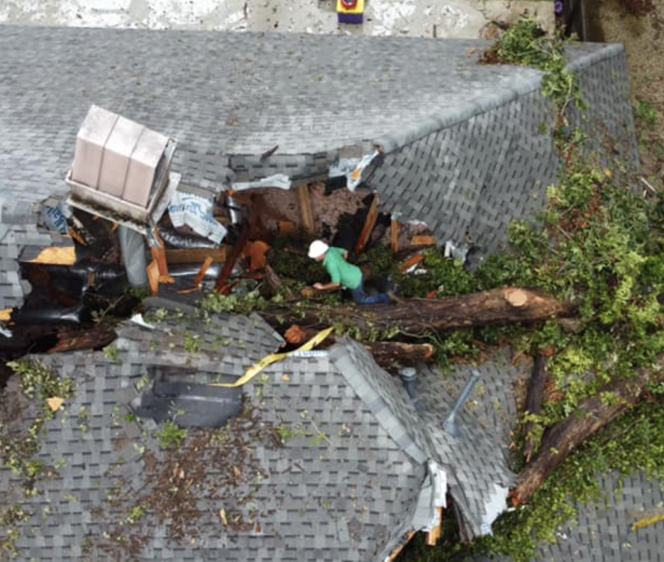 A hole in the roof of a Louisiana home after a tree crashed through it.