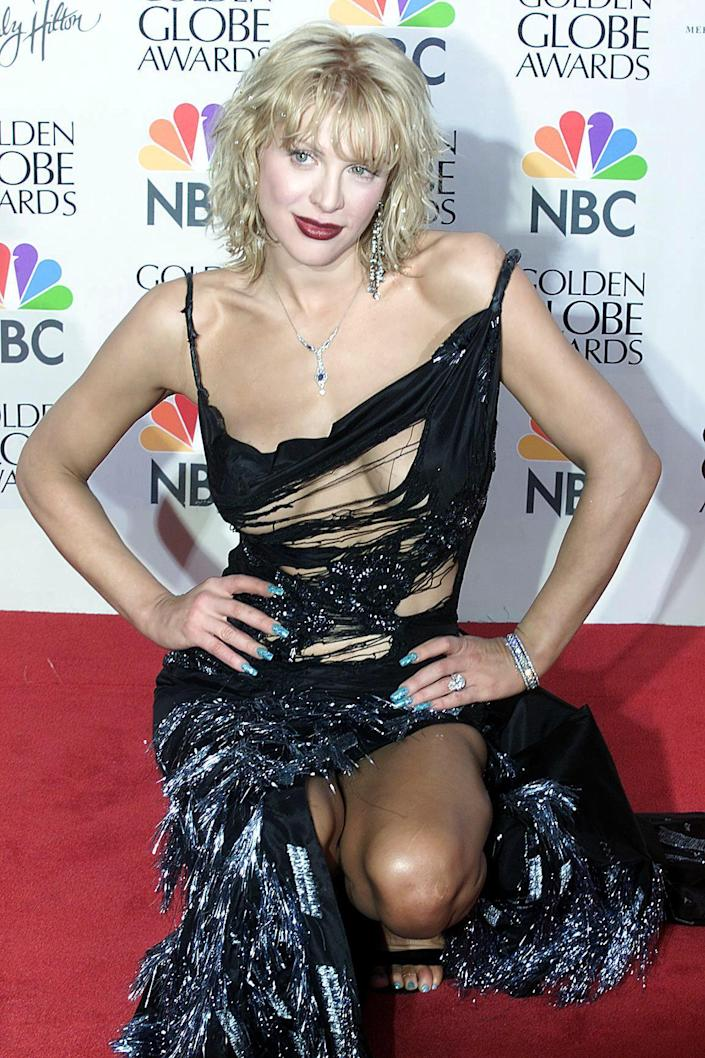 Actress Courtney Love poses for photographers during the 57th Golden Globe Awards in Beverly Hills, January 23, 2000.
