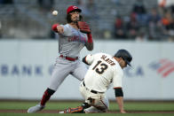 Cincinnati Reds second baseman Jonathan India (6) throws over San Francisco Giants' Austin Slater (13) too late to double up Donovan Solano at first during the first inning of a baseball game, Monday, April 12, 2021, in San Francisco, Calif. (AP Photo/D. Ross Cameron)
