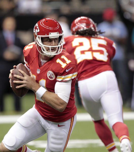 Kansas City Chiefs quarterback Alex Smith (11) scrambles during the first half of an NFL football game against the New Orleans Saints at the Superdome in New Orleans, Friday, Aug. 9, 2013. (AP Photo/Matthew Hinton)