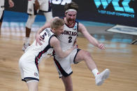 Gonzaga forward Drew Timme (2) celebrates with Gonzaga guard Martynas Arlauskas (5) after an Elite 8 game against Southern California in the NCAA men's college basketball tournament at Lucas Oil Stadium, Tuesday, March 30, 2021, in Indianapolis. Gonzaga won 85-66. (AP Photo/Michael Conroy)