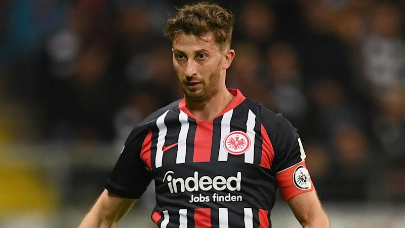 Frankfurt football captain David Abraham banned, fined for barge on Freiburg coach