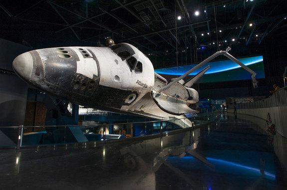 """Space shuttle Atlantis, as displayed inside the new $100 million """"Space Shuttle Atlantis"""" exhibit that opened Saturday, June 29, 2013, at NASA's Kennedy Space Center Visitor Complex in Florida."""