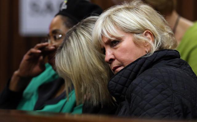 June Steenkamp, center, mother of Reeva Steenkamp, bows her head while listening to forensic evidence in Pretoria, South Africa, Thursday, April 17, 2014 at the murder trial of Oscar Pistorius. One of Oscar Pistorius' defense experts was grilled by the chief prosecutor for the second day at the Olympic runner's murder trial Thursday, with forensic specialist Roger Dixon's expertise and professionalism in conducting various tests regarding Reeva Steenkamp's shooting death again sternly questioned. Pistorius is charged with premeditated murder for shooting Steenkamp multiple times on Feb. 14, 2013. Prosecutors say that he killed Steenkamp after a fight. The trial was adjourned until May 5. (AP Photo/Themba Hadebe, Pool)