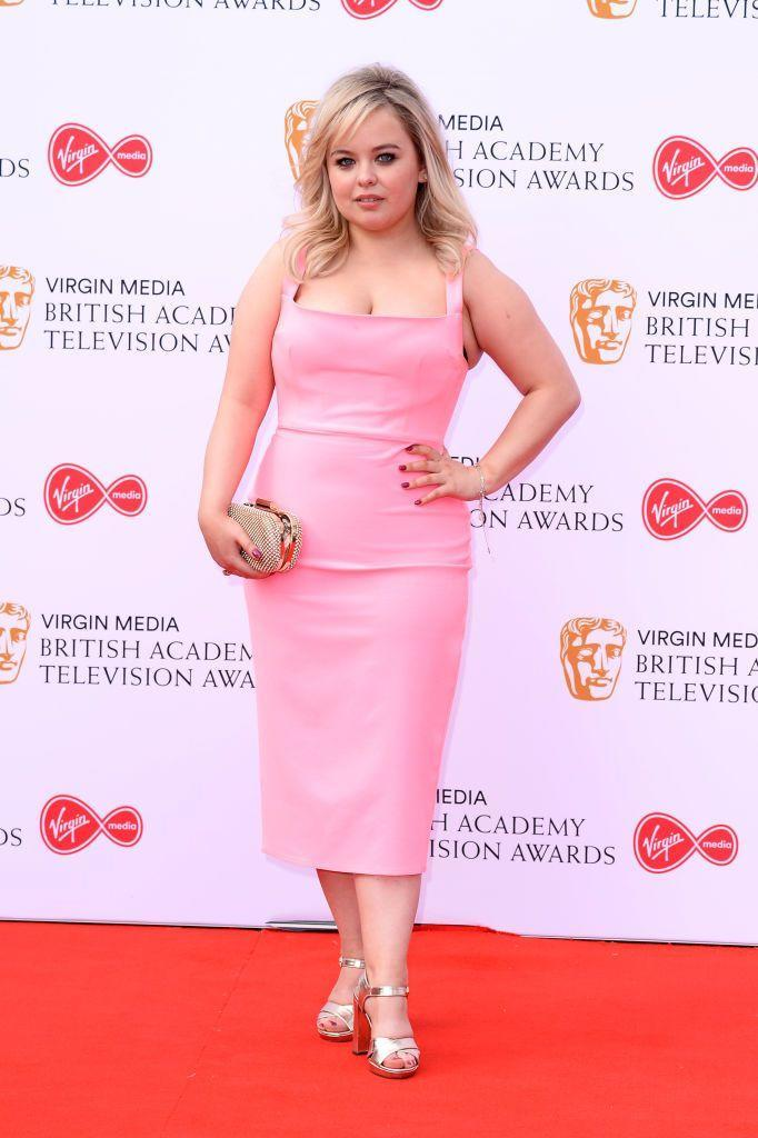 <p>Coughlan wore a pink wiggle dress by Alex Perry to the red carpet event. </p>