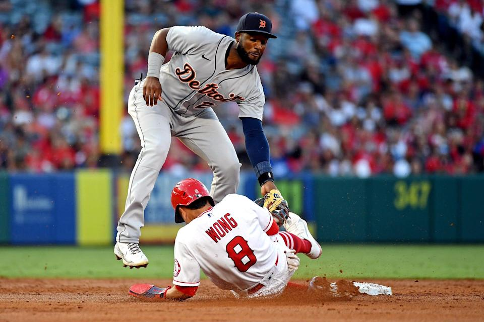 Detroit Tigers third baseman Niko Goodrum tags out Los Angeles Angels second baseman Kean Wong as he tries to steal second base during the second inning at Angel Stadium, June 18, 2021.