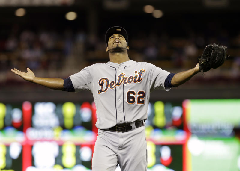 Detroit Tigers relief pitcher Al Alburquerque celebrates as he heads to the dugout after Minnesota Twins' Brian Dozier grounded out to end the seventh inning in a baseball game, Tuesday, Sept. 24, 2013, in Minneapolis. The Tigers won 4-2. (AP Photo/Jim Mone)
