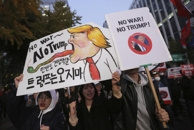 "<p>Protesters march toward the U.S. Embassy during a rally to oppose a planned visit by the President Donald Trump in Seoul, South Korea, Saturday, Nov. 4, 2017. The signs read "" We oppose Trump's visit."" (Photo: Ahn Young-joon/AP) </p>"